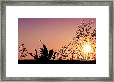 Fairy At The Bottom Of The Garden Framed Print