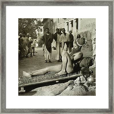 Fakir On His Bed Of Spikes Framed Print by Library Of Congress