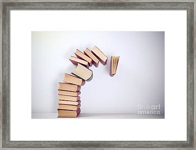 Falling Books Framed Print