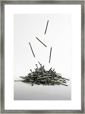 Falling Nails Framed Print