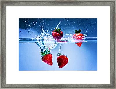 Falling Strawberries Framed Print