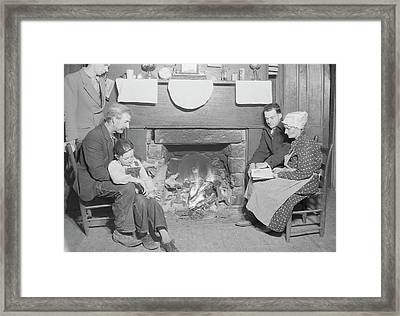 Family By Fireplace At Their Home Framed Print