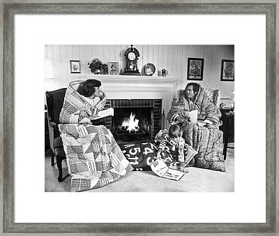 Family Huddled By Fireplace Framed Print by Underwood Archives