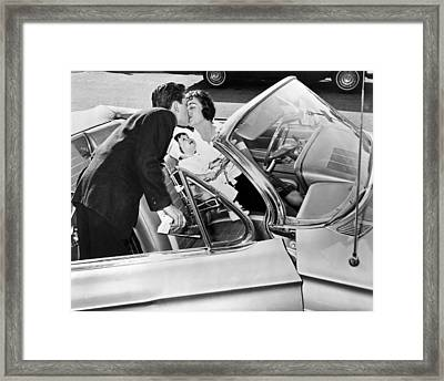 Family Kiss Framed Print by Underwood Archives