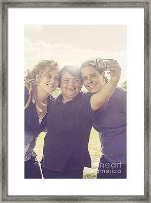 Family Taking Summer Selfies Framed Print