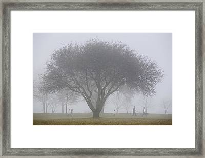 Family Walking Through Park In The Framed Print by Mary Ellen McQuay