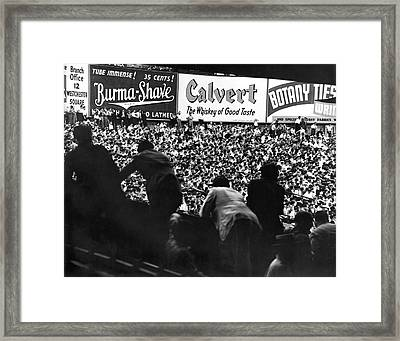 Fans In The Bleachers During A Baseball Game At Yankee Stadium Framed Print by Underwood Archives