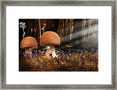 Fantasy Image Of Toadstool Houses In Bluebell Woods Framed Print by Matthew Gibson