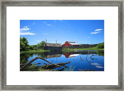 Farm Buildings And Pond. Framed Print by Jim Sauchyn