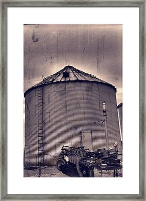 Farm Equipment And Silo Framed Print by Dan Sproul
