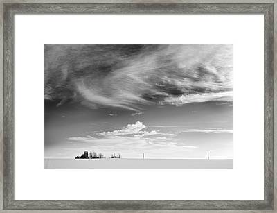 Farm In The Distance In A Snowy Field Framed Print by Patrick LaRoque