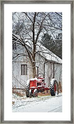 Farmall Tractor In Winter Framed Print by Timothy Flanigan
