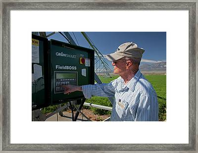 Farmer Adjusting Irrigation Controls Framed Print by Jim West
