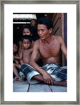 Farmer And Family In Laos Framed Print by Carl Purcell