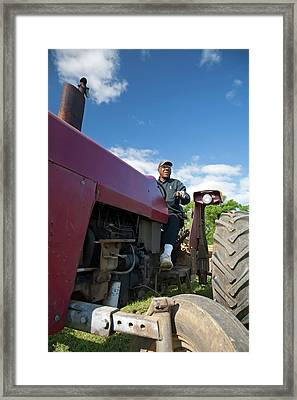Farmer On A Tractor Framed Print by Jim West