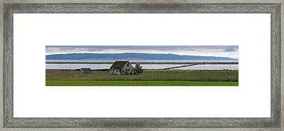 Farmhouse In A Field Along Shore Framed Print by Panoramic Images