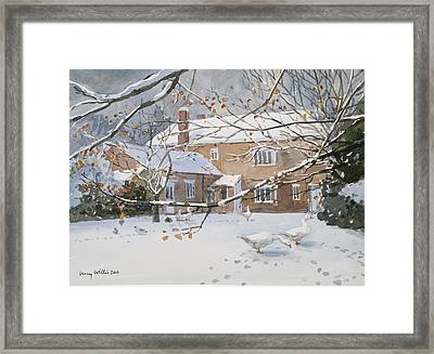 Farmhouse In The Snow Framed Print by Lucy Willis