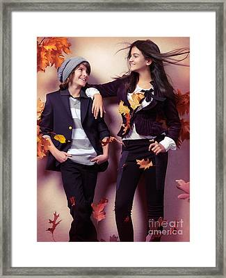 Fashionably Dressed Boy And Teenage Girl Under Falling Autumn Le Framed Print by Oleksiy Maksymenko