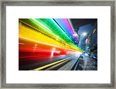 Fast Moving Bus At Night Framed Print by Konstantin Sutyagin