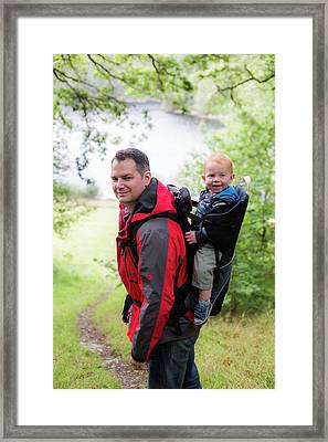 Father Carrying Son In Back Carrier Framed Print