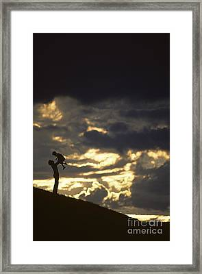 Father Holding Daughter Above His Head Along Hillside Silhouette Framed Print