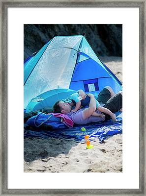 Father Holding Son In A Tent On Beach Framed Print