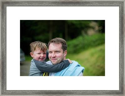 Father Holding Son Framed Print by Samuel Ashfield