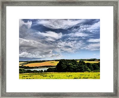 Feather Clouds Over Fields Framed Print by Winifred Butler