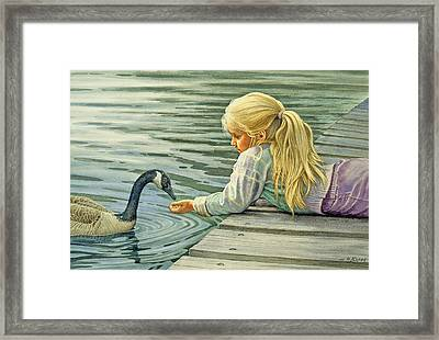 Feeding The Canada Goose Framed Print