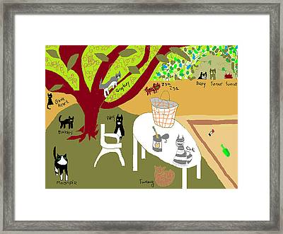Feeding The Cats At The Park Framed Print by Anita Dale Livaditis