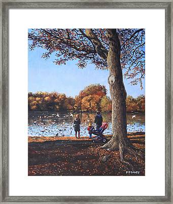 Feeding The Ducks At Southampton Common Framed Print by Martin Davey