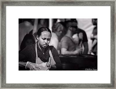 Feeding The Multitudes Framed Print by Wallaroo Images