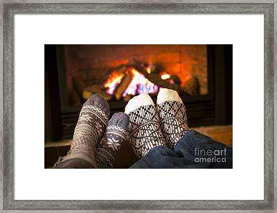 Feet Warming By Fireplace Framed Print by Elena Elisseeva