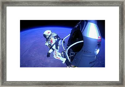 Felix Baumgartner Jumping From Capsule Framed Print by Science Photo Library