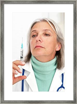 Female Doctor Holding Injection Framed Print by Lea Paterson