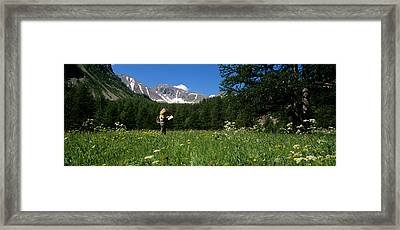 Female Hiker Holding A Map Framed Print by Panoramic Images