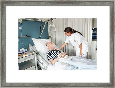 Female Nurse With Hand On Patient's Shoulder Framed Print by Arno Massee/science Photo Library