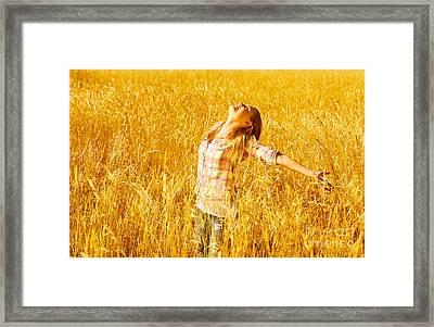 Female On Wheat Field Framed Print