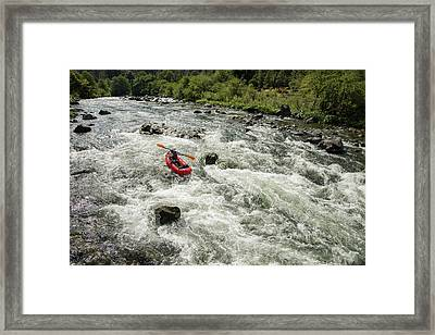 Female Rafters Pushing Through A Rapid Framed Print