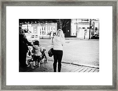 female shopper waiting to cross the road corner of granville and west georgia streets Vancouver BC C Framed Print by Joe Fox