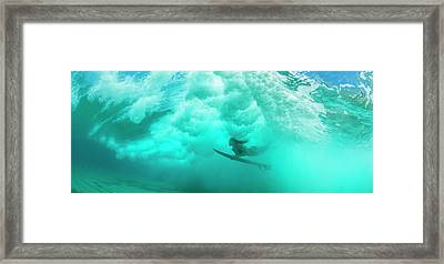 Female Surfer Pushes Under A Wave While Framed Print by Panoramic Images