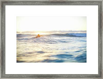 Female Surfer Swimming Out To Waves On Framed Print by Moof