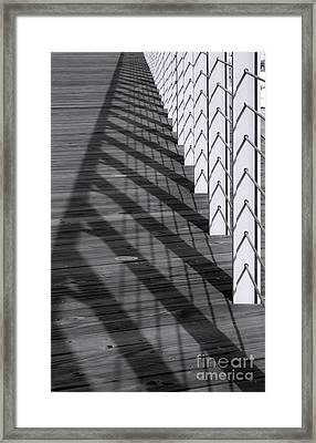 Fence And Shadows Framed Print