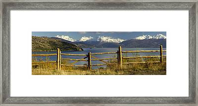 Fence In Front Of A Lake With Mountains Framed Print
