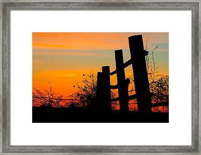 Fence Line With Vibrant Sky Framed Print by Kirk Strickland
