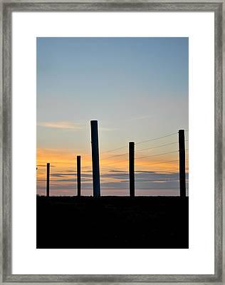 Fence Posts At Sunset Framed Print
