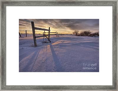 Fenceline At Sunset Framed Print by Dan Jurak