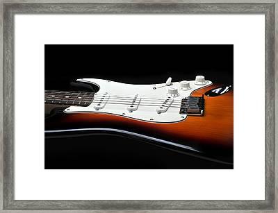 Fender Stratocaster Guitar On Black Background Framed Print