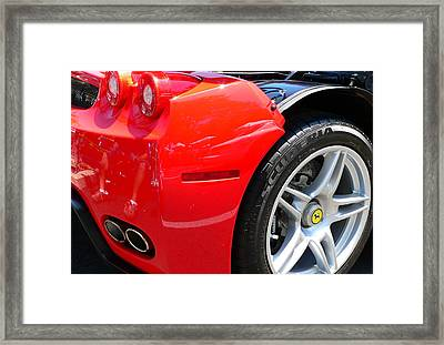 Framed Print featuring the photograph Ferrari Rear Panel And Tire by Jeff Lowe