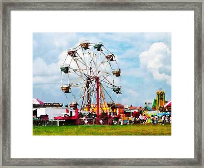 Ferris Wheel Against Blue Sky Framed Print by Susan Savad